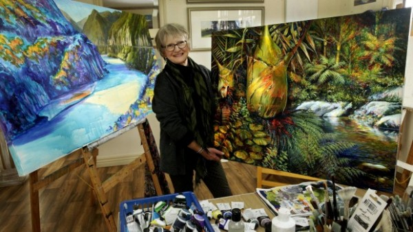 Vonni Sterritt with two of her large paintings