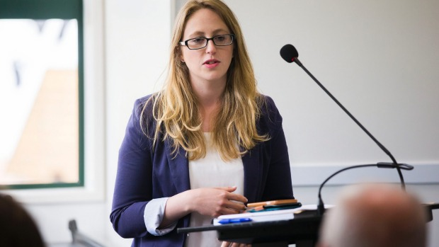 Lea Godden presenting at a lectern
