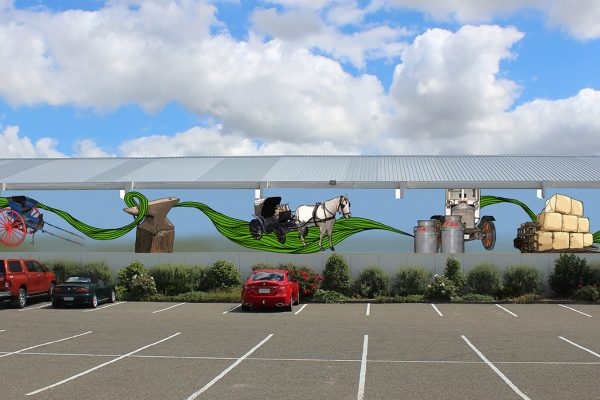 Mural art along a wall showing different forms of transport